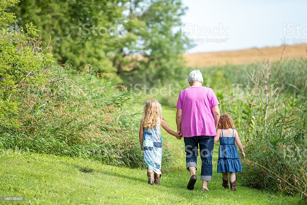 Two Young Girls & Grandma Going For Walk on Farm stock photo