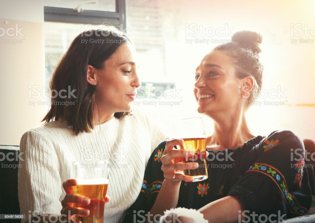 Two young girls having fun together in the restaurant stock photo