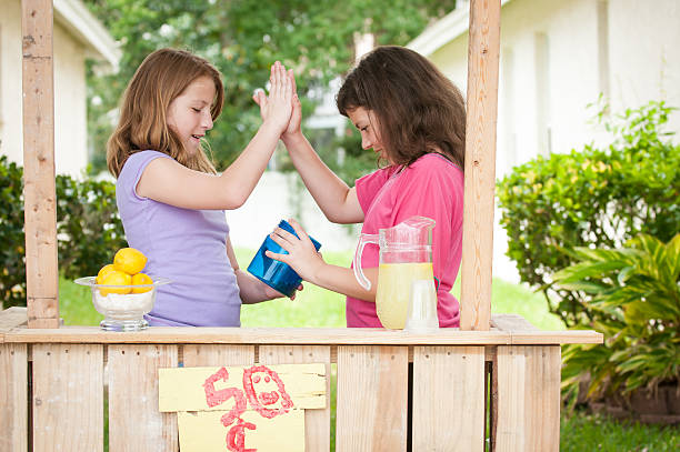 Two young girls high fiving stock photo