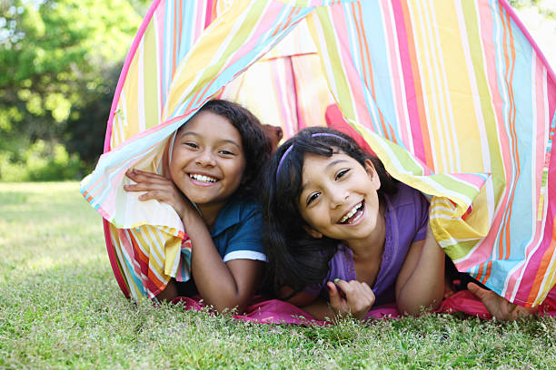 Two young girls in a pastel tent stock photo