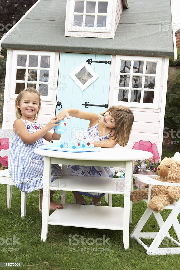Two young girls play outdoors stock photo