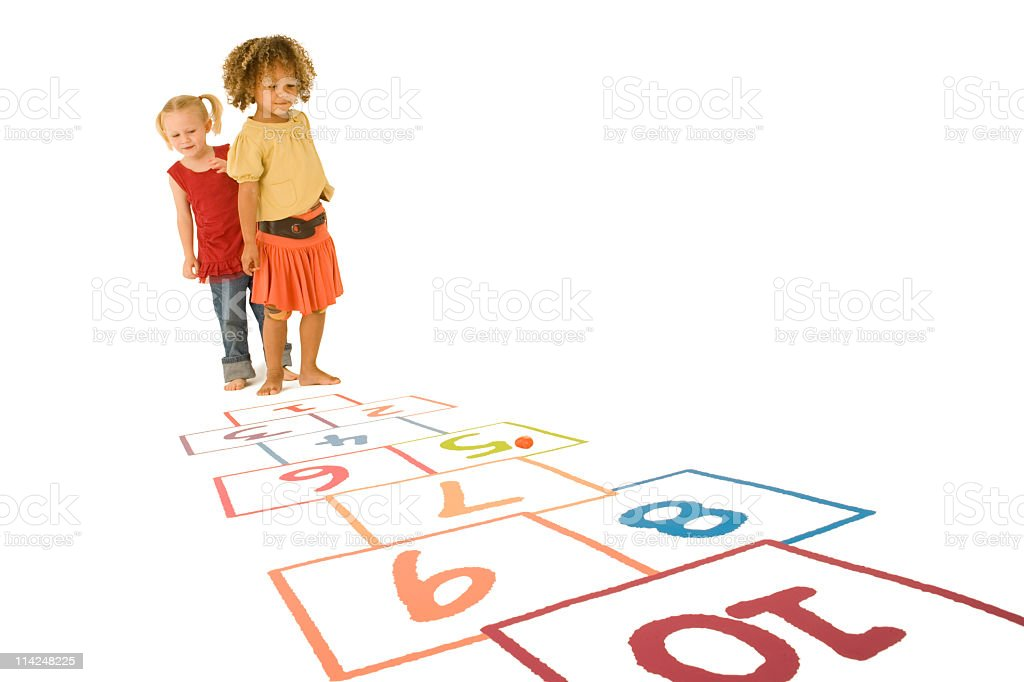 Two young girls playing Hopscotch stock photo