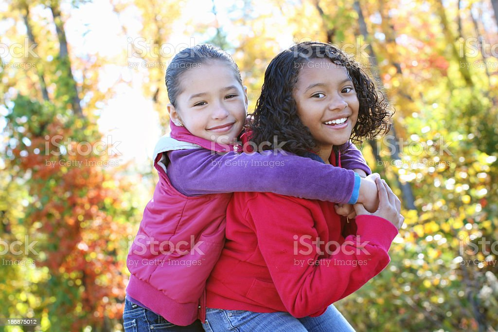 Two young girls playing outside stock photo