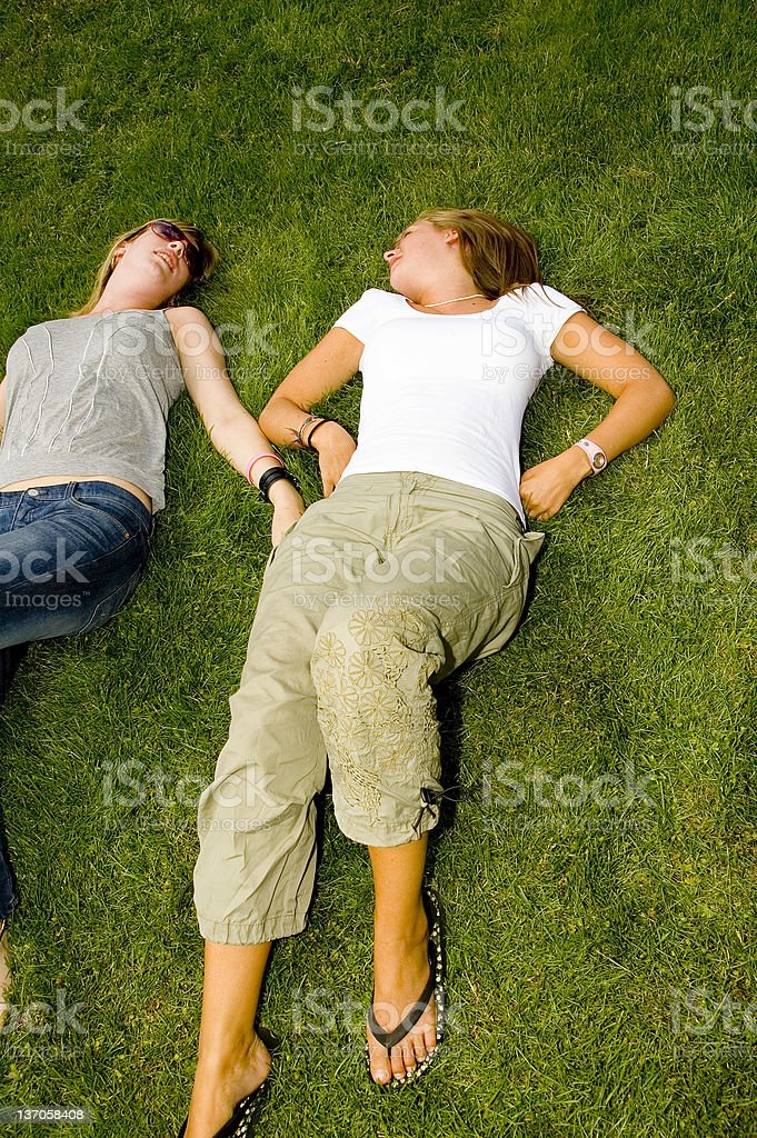 Two young girls relax  in the sun royalty-free stock photo