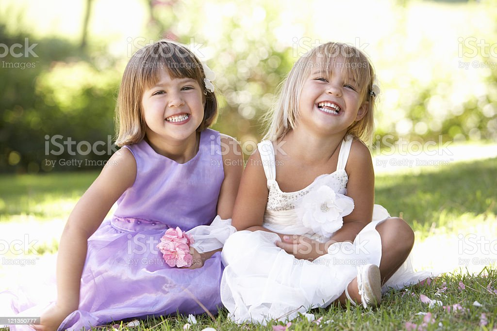 Two young girls sitting in park royalty-free stock photo