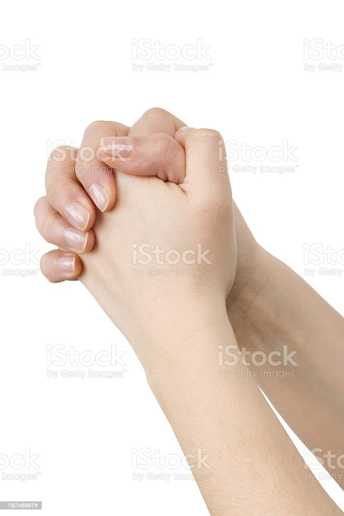 Two young hands clasped in a praying position royalty-free stock photo