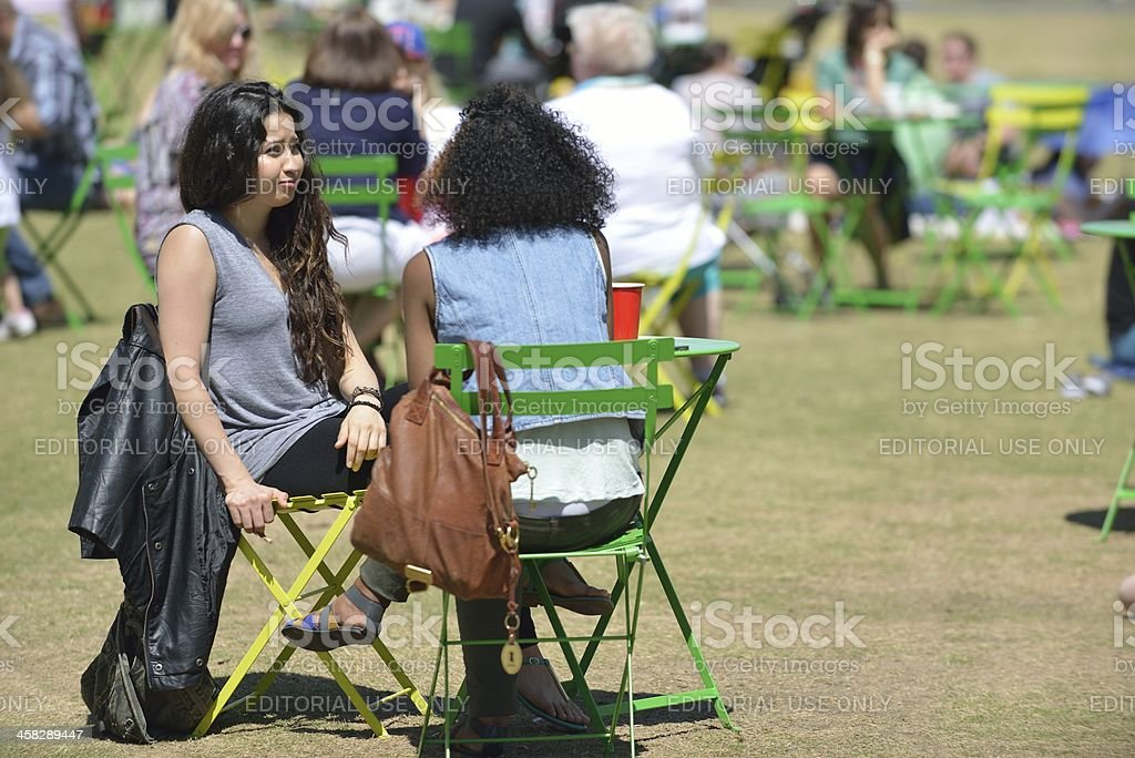 Two young Hispanic girls enjoy a day at the park stock photo