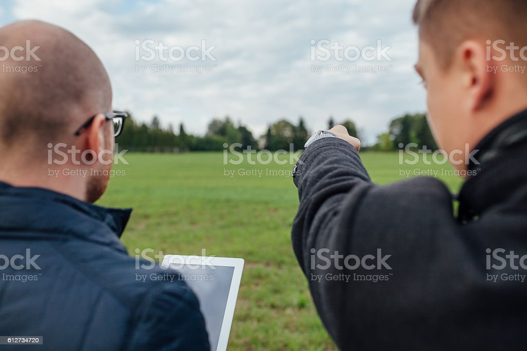 Two young investors are having a business meeting and one stock photo