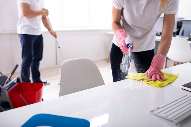 Two Young Janitor Cleaning The Office stock photo