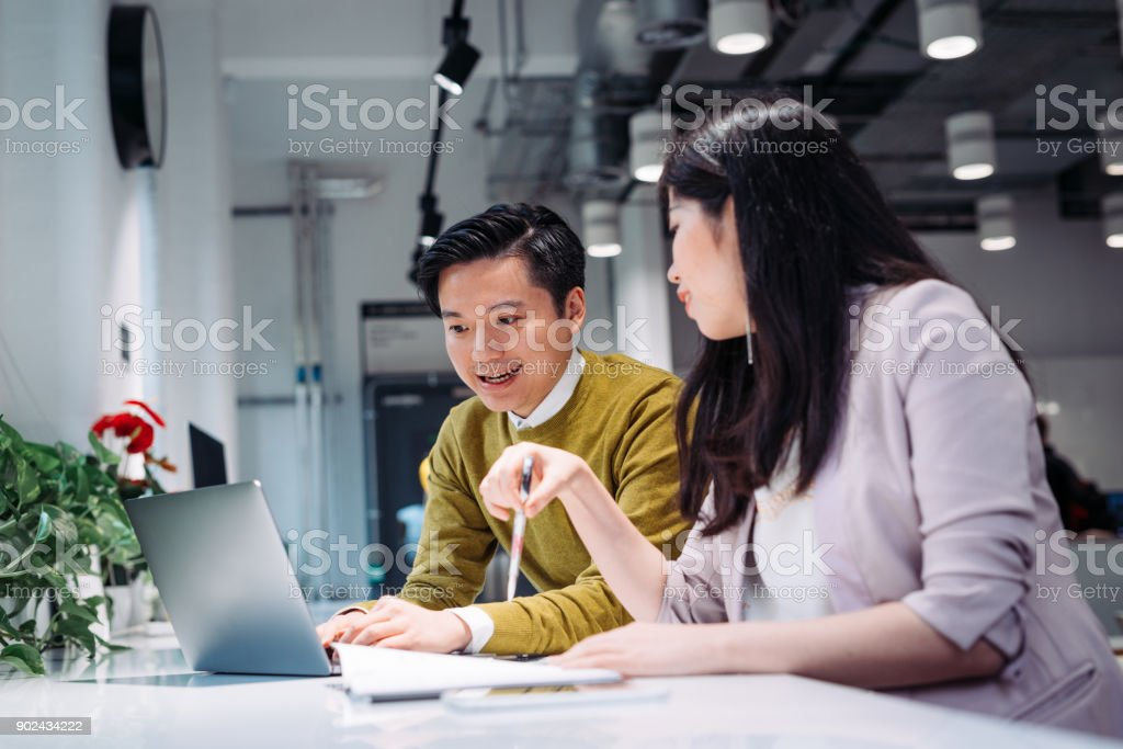 Two Young Korean Entrepreneurs Trading Cryptocurrencies In Modern Cafe Stock Photo Download Image Now Istock