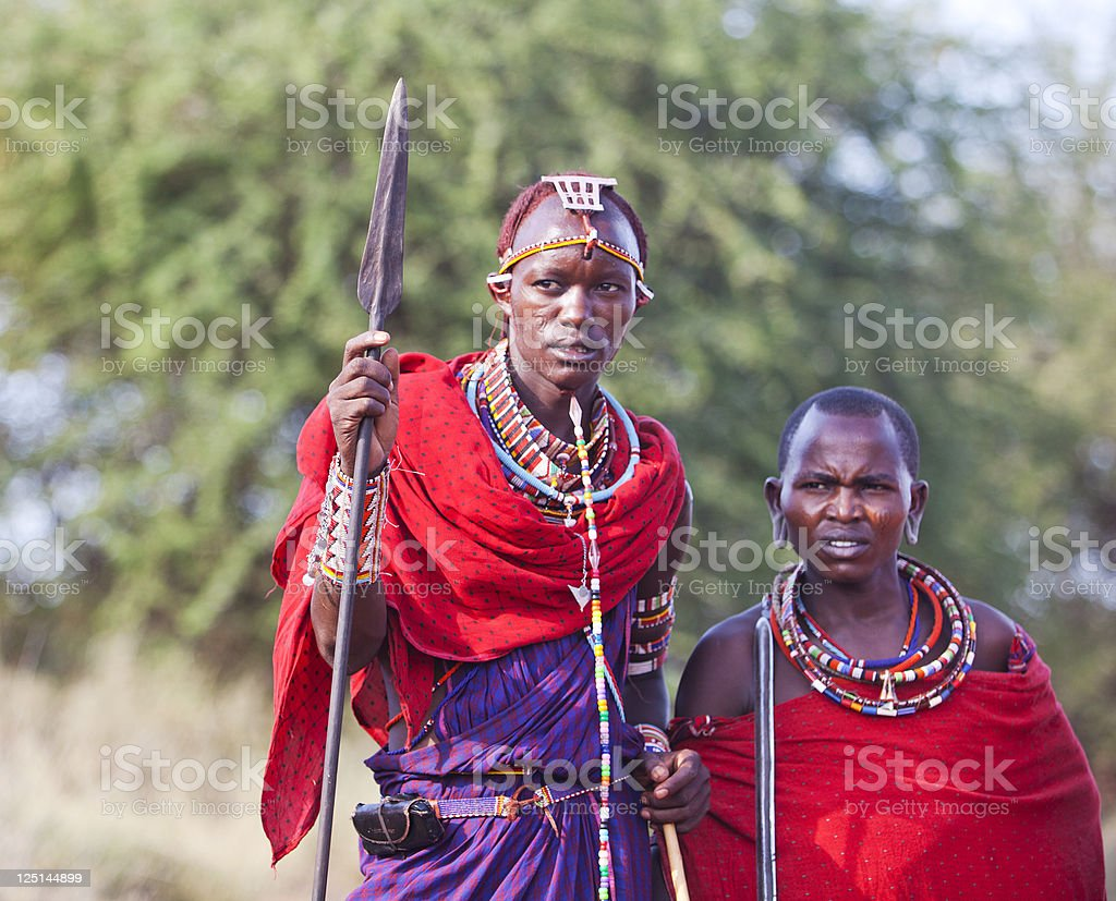 Two young maasai warriors with spears and traditional dress. stock photo