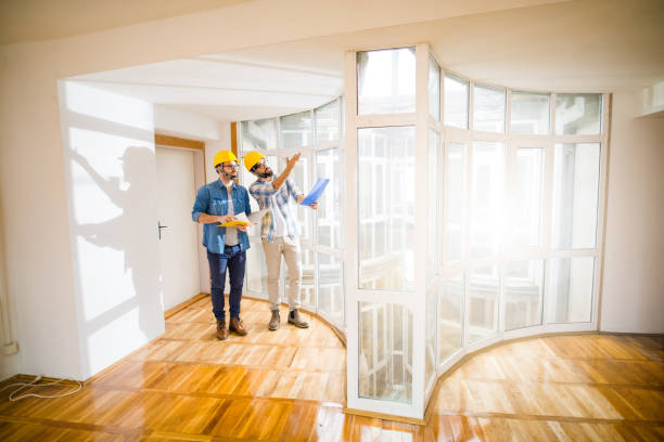 Two young male architects walking through an empty apartment a talking about some changes . Two young male architects walking through an empty apartment a talking about some changes . general military rank stock pictures, royalty-free photos & images