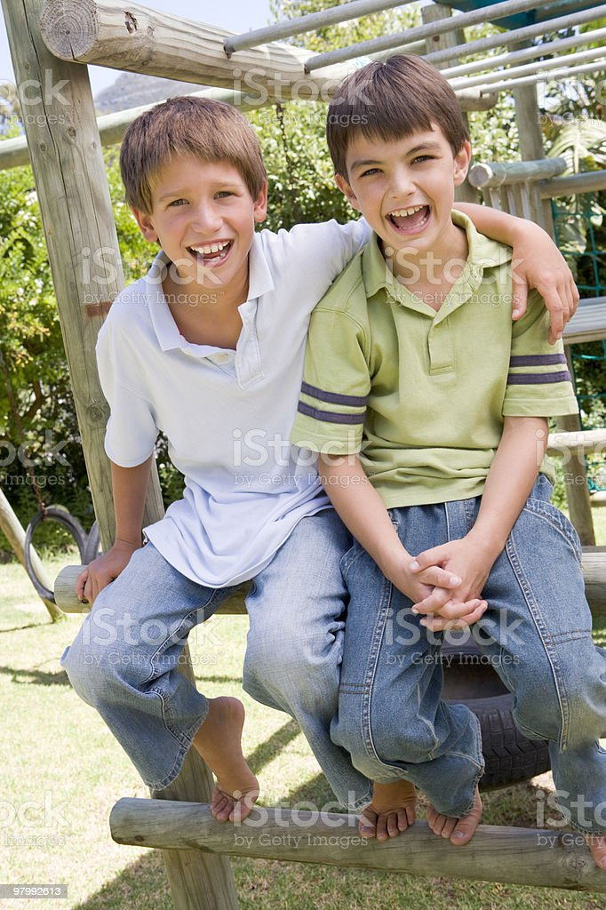 Two young male friends at a playground royalty-free stock photo