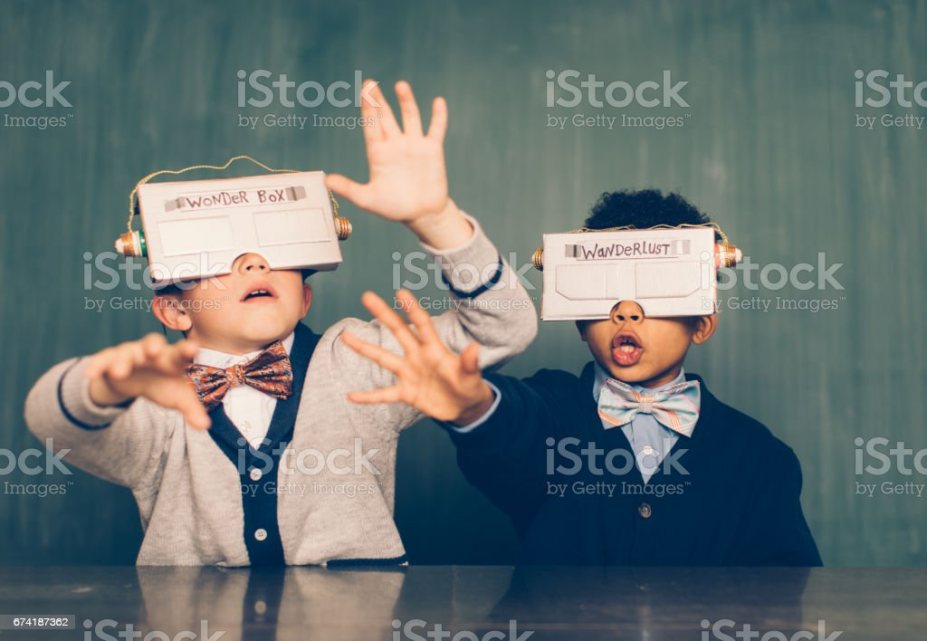 Two Young Male Nerds with Virtual Reality Headsets stock photo