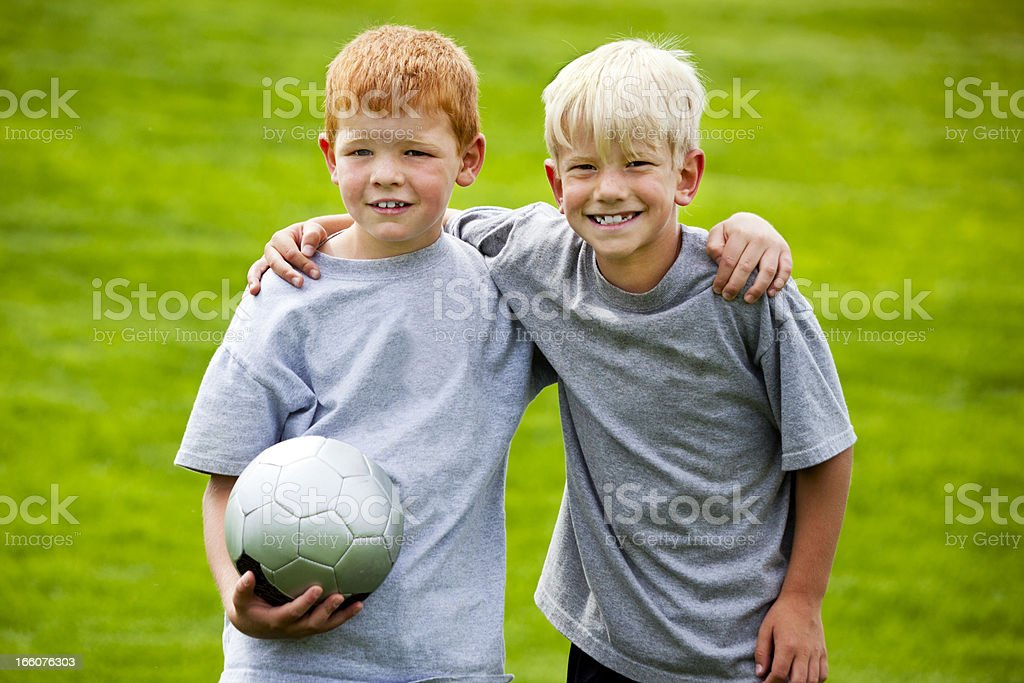 Two Young Male Soccer Players are Buddies royalty-free stock photo