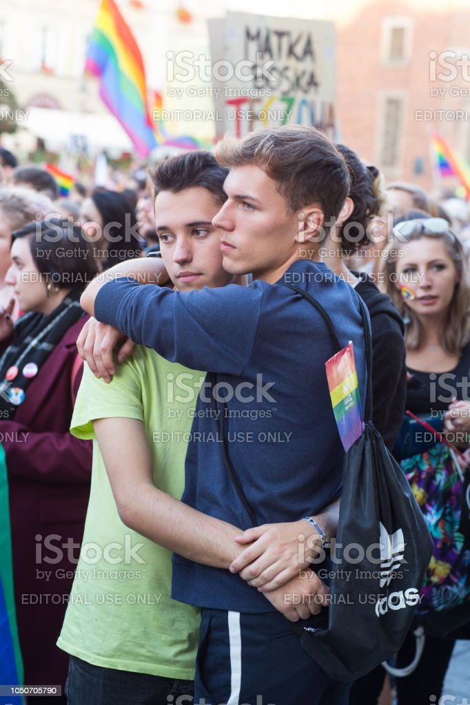 Two young man hugging each other at LGBT parade stock photo