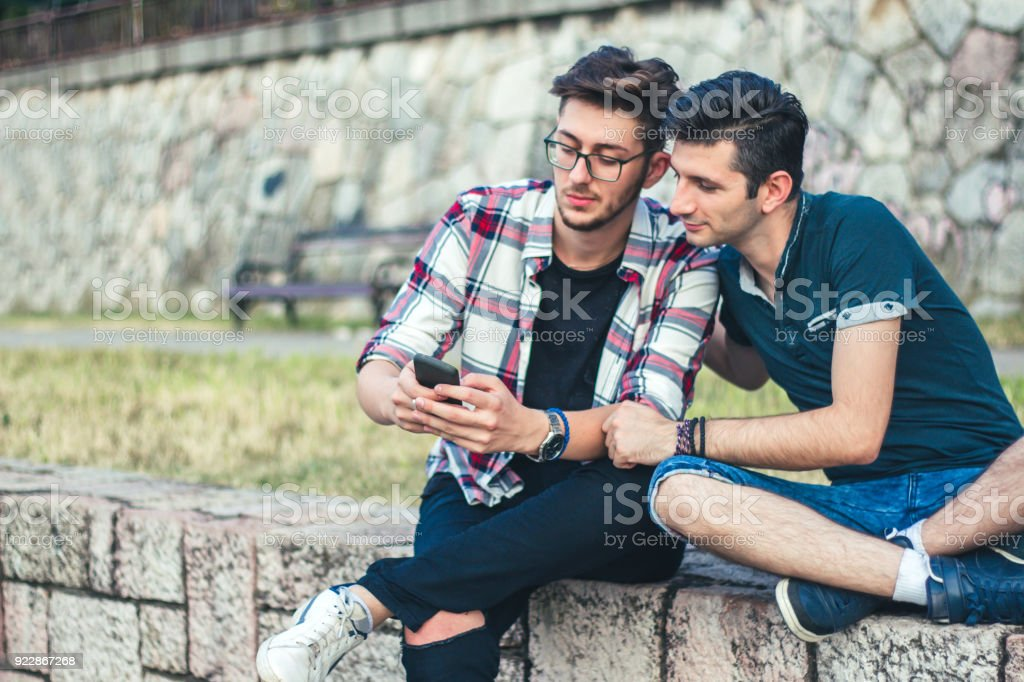 Two Young Man looking at Mobile Phone
