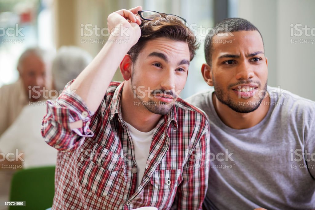 Two young man making faces stock photo