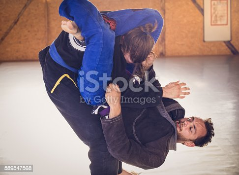istock Two Young Martial Arts Athletes During Exercise 589547568