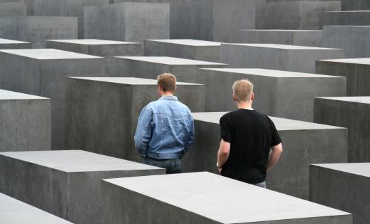 Two young men by the Holocaust Memorial in Berlin, Germany