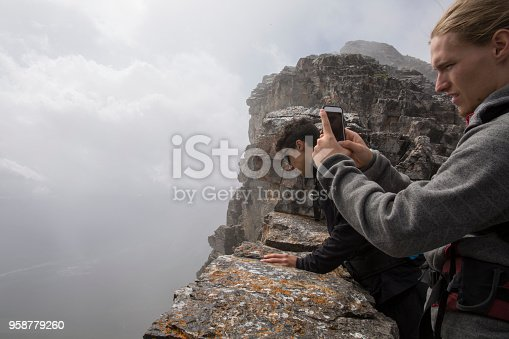 istock Two young men explore cliff edge on Mount Yamnuska 958779260