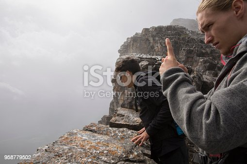 istock Two young men explore cliff edge on Mount Yamnuska 958779502