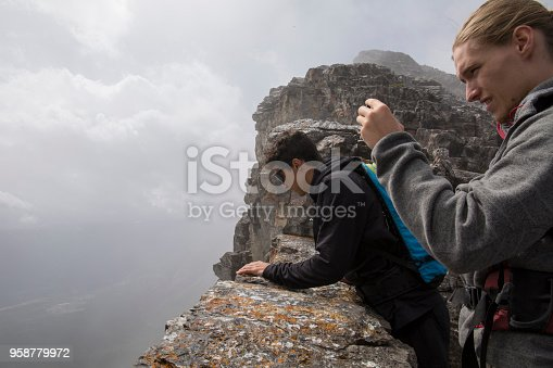 istock Two young men explore cliff edge on Mount Yamnuska 958779972