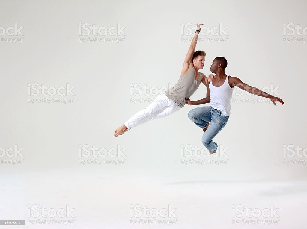 Two young men in mid air stock photo