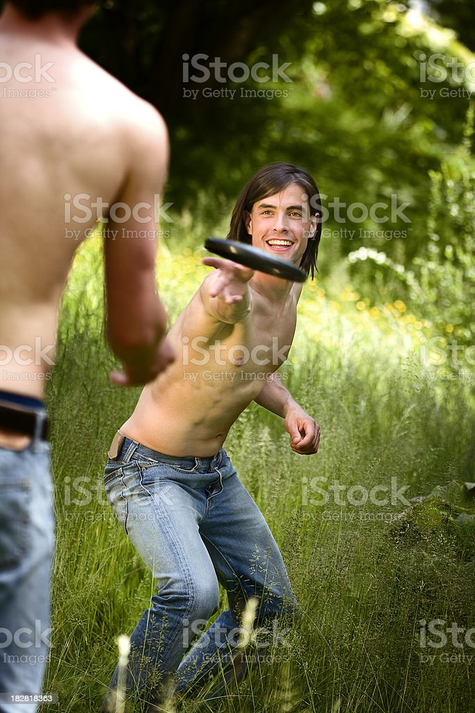 Two Young Men Playing Frisbee royalty-free stock photo