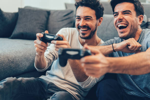 Two Young Men Playing Video Game stock photo