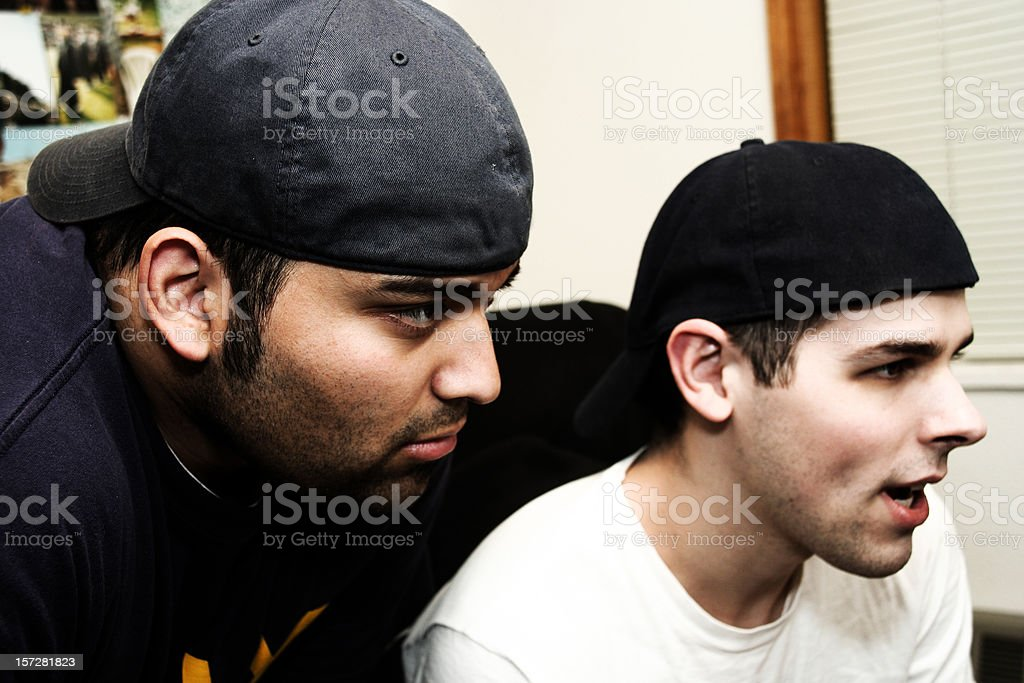 Two Young Men Playing Video Games royalty-free stock photo