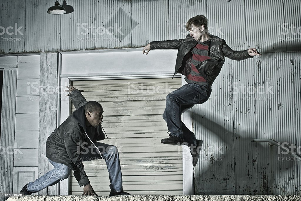 Two Young Men Practicing Kenpo Karate on the Street stock photo