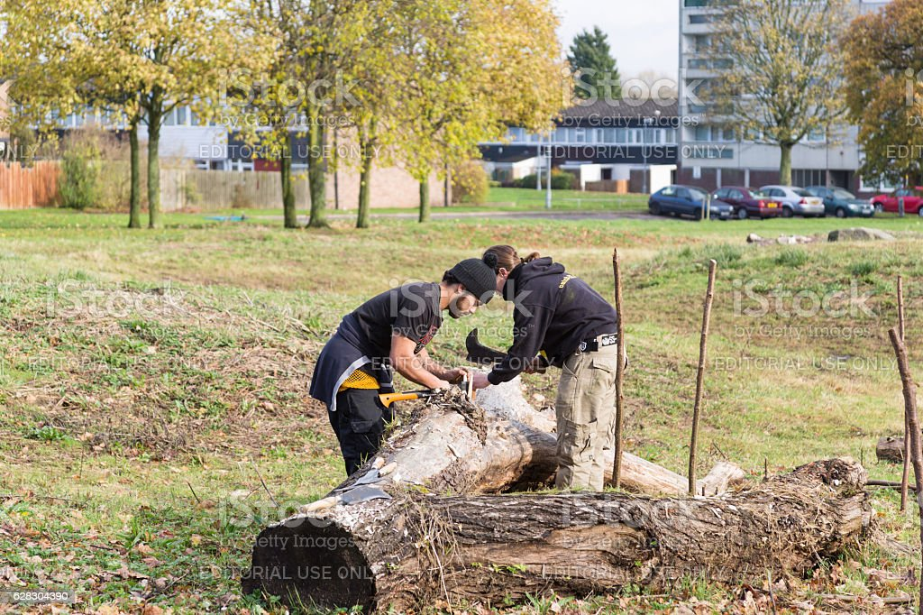 Two young men using traditional tools stock photo