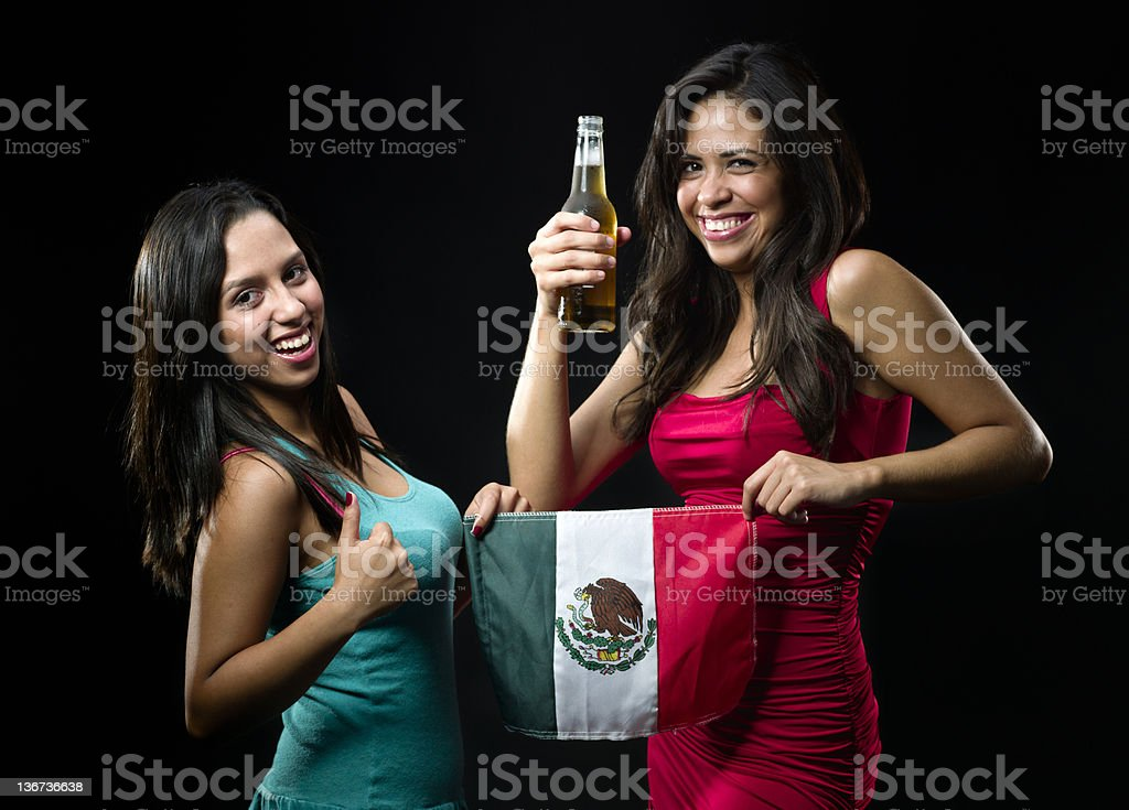 Two young mexican woman celebrating royalty-free stock photo