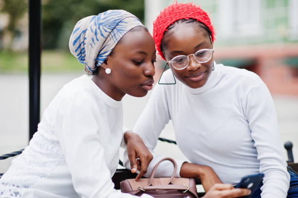 Two young modern fashionable, attractive, tall and slim african muslim womans stock photo