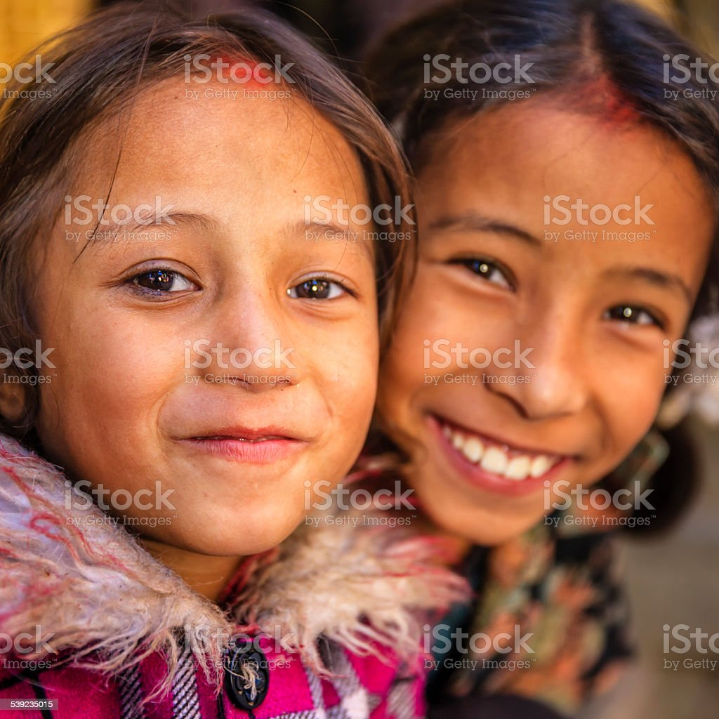 Two young Nepali girls in one of Bhaktapur's temples royalty-free stock photo