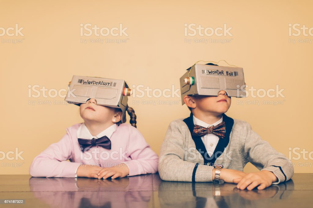 Two Young Nerds with Virtual Reality Headsets stock photo
