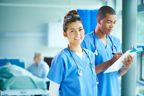two young nurses on the ward - female nurse stock photos and pictures