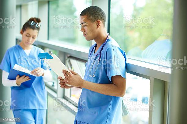 Two Young Nurses On The Ward Stock Photo - Download Image Now