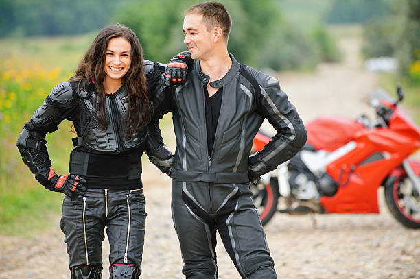 two young people against motorbike stock photo