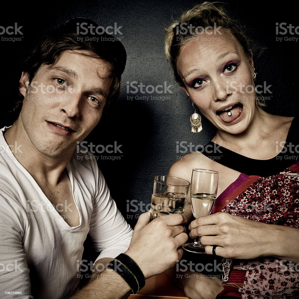 Two Young People Drinking Alcohol and Having Fun royalty-free stock photo