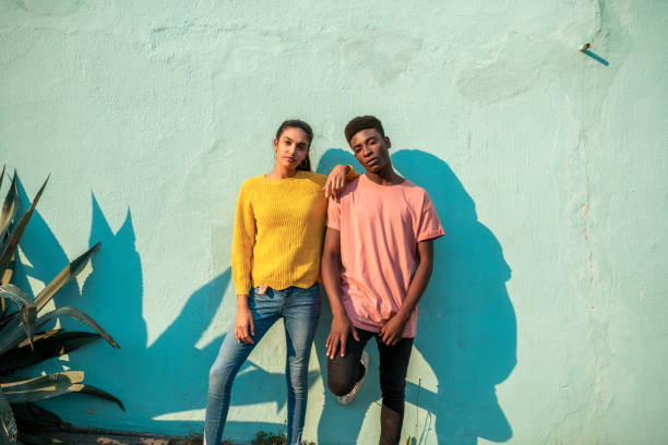 Two young people looking at the camera. stock photo