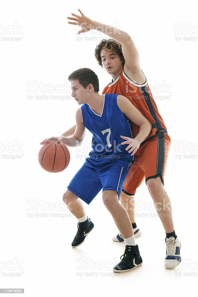 Two young players for different teams playing basketball stock photo