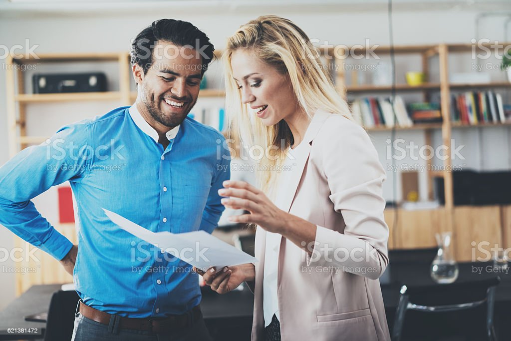 Two young professionals making a great business discussion in modern stock photo