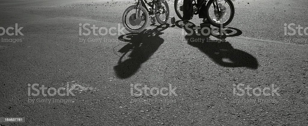two young riders bike and shadows at night royalty-free stock photo