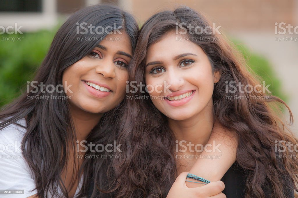 Two young sisters of South Asian ethnicity having a good time together