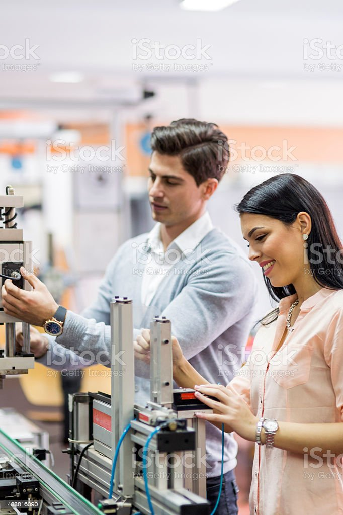 Two young students working on a project together in lab stock photo