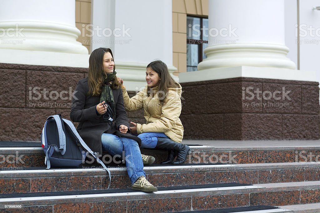 Two young teenage students between classes royalty-free stock photo