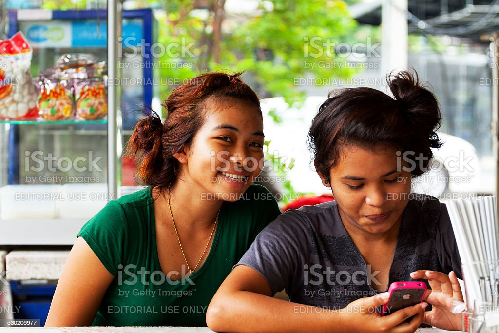 Two Young Thai Girls At Table Stock Photo - Download Image
