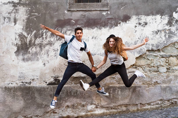 Two young tourists in the old town, having fun. stock photo